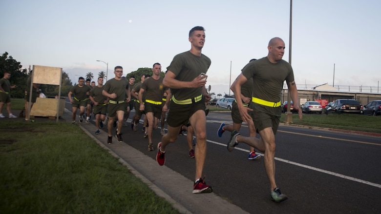 Marines with Headquarters Battalion begin a 3-mile run during their Physical Fitness Test at Marine Corps Base Hawaii, March 14, 2017. The PFT is an evaluation conducted throughout the Marine Corps annually to assess the level of fitness. For more information on the PFT updates, utilize Marine Corps Bulletin 6100.