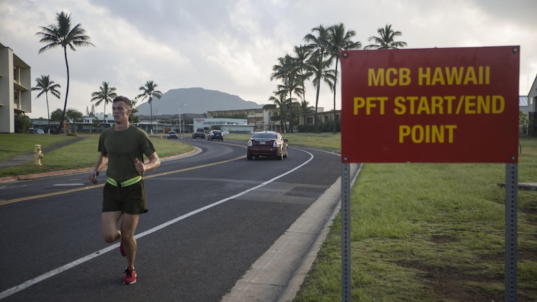 Sgt. Ty Stulce, a platoon sergeant with Headquarters Battalion, crosses the finish line from a 3-mile run during a Physical Fitness Test at Marine Corps Base Hawaii, March 14, 2017. The PFT is an evaluation conducted throughout the Marine Corps annually to assess the level of physical fitness. For more information on the PFT updates, utilize Marine Corps Bulletin 6100.