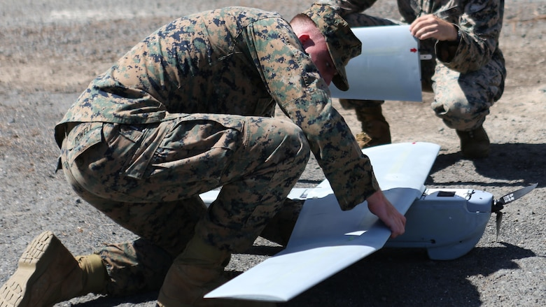 Lance Cpl. Nicholas Powell and Sgt. Chris Gyurgyik, both with 1st Battalion, 12th Marine Regiment, set up an Unmanned Aerial System at Marine Corps Training Area Bellows, March 8, 2017. The UAS is mainly used for aerial reconnaissance and can also be used for observation, local security, targeting, and prosecuting.