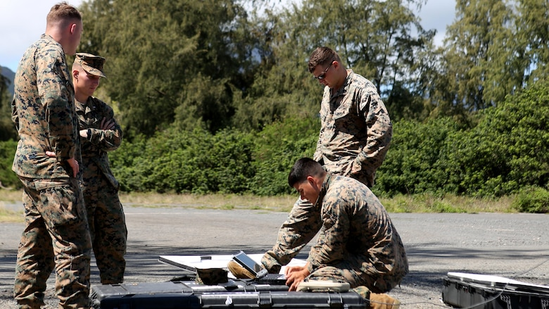 Marines with 1st Battalion, 12th Marine Regiment, do last minute checks to make sure their Unmanned Aerial System doesn't fail at Marine Corps Training Area Bellows, Hawaii, March 8, 2017. The UAS is mainly used for aerial reconnaissance and can also be used for observation, local security, targeting, and prosecuting.