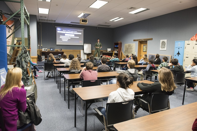 Kadena Middle School students listen to a lecture on F-15 Eagle history during a Science, Technology, Engineering and Math tour at the 18th Operations Support Squadron March 3, 2017, at Kadena Air Base, Japan. Students learned about how STEM is used every day at Kadena AB.  (U.S. Air Force photo by Senior Airman Omari Bernard)