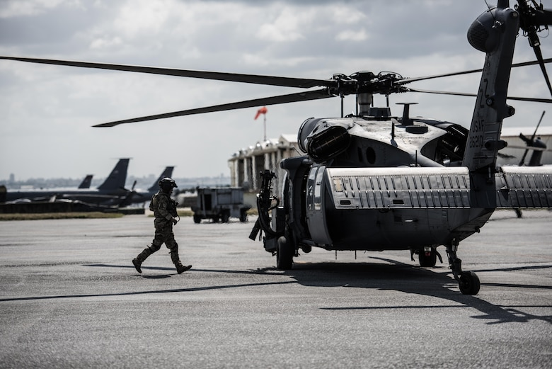 An Airmen from the 33rd Rescue Squadron dashes back to a running HH-60 Pavehawk during hot-refueling during routine training on the flightline March 7, 2017, at Kadena Air Base, Japan. Members of the 33rd Rescue Squadron from Kadena AB train to provide support for combat rescue and disaster relief. (U.S. Air Force photo by Senior Airman Omari Bernard)