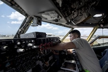 U.S. Air Force Airman 1st Class Ryan Celestino, 909th Aircraft Maintenance Unit instrument and flight control systems journeyman, removes and replaces a digital speed indicator from the dashboard of a KC-135R March 15, 2017, at Kadena Air Base, Japan. Maintainers from the 909th AMU ensure that the KC-135Rs in their care are operational and mission ready.  (U.S. Air Force photo by Senior Airman Omari Bernard)