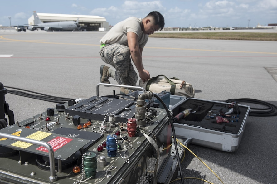 U.S. Air Force Airman 1st Class Ryan Celestino, 909th Aircraft Maintenance Unit instrument and flight control systems journeyman, sets up equipment to perform maintainance on a KC-135R March 15, 2017, at Kadena Air Base, Japan. Maintenance Airmen use assorted sets of tools to ensure the mission capability of their aircraft. (U.S. Air Force photo by Senior Airman Omari Bernard)