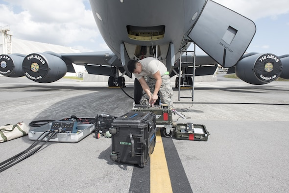 U.S. Air Force Airman 1st Class Ryan Celestino, 909th Aircraft Maintenance Unit instrument and flight control systems journeyman, turns on a TTU-205J test set to perform pitot-static tests for the KC-135R March 15, 2017, at Kadena Air Base, Japan. Pito-static tests allows maintainers to simulate diagnostic readings for jets in the air on the ground. (U.S. Air Force photo by Senior Airman Omari Bernard)