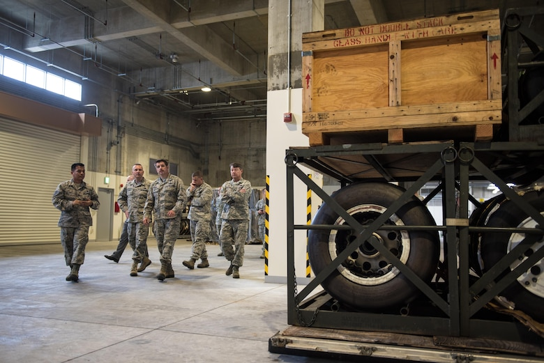 Commanders from the 18th Wing tour one of two new 18th Logistics Readiness Squadron facilities March 13, 2017, at Kadena Air Base, Japan. The facilities can contain anything from fighter jet parts to cooking supplies. The new facilities hold more than a billion dollars of U.S. Air Force assets and was funded in part by the government of Japan. (U.S. Air Force photo by Senior Airman Omari Bernard)