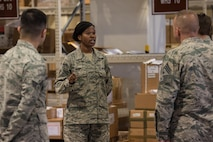 U.S. Air Force Staff Sgt. Latoya Henry, 18th Logistics Readiness Squadron integrated receiving supervisor, talks about the mission capabilities of their new LRS facility, March 13, 2017, at Kadena Air Base, Japan. The facilities are equipped with a conveyor belt system, floor mounted scales, and adjustable loading docks. (U.S. Air Force photo by Senior Airman Omari Bernard)