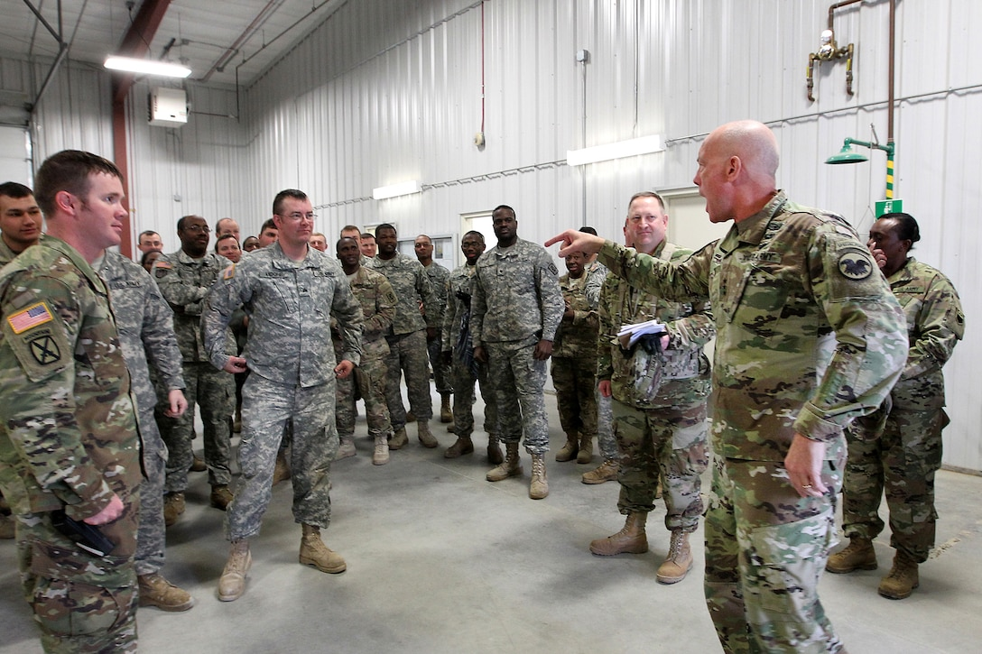 """LTG Charles Luckey, right, Commanding General, U.S. Army Reserve, yells out his signature phrase """"Keep Pounding!"""" to the first crews that qualified during Operation Cold Steel in a second visit to the exercise at Fort McCoy, Wisconsin, Mar. 18, 2017. Operation Cold Steel is the U.S. Army Reserve's crew-served weapons qualification and validation exercise to ensure that America's Army Reserve units and Soldiers are trained and ready to deploy on short-notice and bring combat-ready and lethal firepower in support of the Army and joint partners anywhere in the world. 475 crews with an estimated 1,600 Army Reserve Soldiers will certify in M2, M19 and M240 Bravo gunner platforms. (U.S. Army Reserve photo by Master Sgt. Anthony L. Taylor)"""
