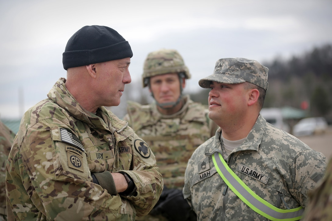 LTG Charles Luckey, left, Commanding General, U.S. Army Reserve, briefly meets with Sgt. 1st Class Joseph Mah, one of a few Master Gunners in the Army Reserve, during Operation Cold Steel in a second visit to the exercise at Fort McCoy, Wisconsin, Mar. 18, 2017. According to the U.S. Army Training and Doctrine Command News Center, a master gunner is a technical and tactical expert and advisor to the commander and advises the commander on anything related to the vehicle platform or weapons system and helps develop all the materials necessary to conduct gunnery and live fire exercises. Operation Cold Steel is the U.S. Army Reserve's crew-served weapons qualification and validation exercise to ensure that America's Army Reserve units and Soldiers are trained and ready to deploy on short-notice and bring combat-ready and lethal firepower in support of the Army and joint partners anywhere in the world. 475 crews with an estimated 1,600 Army Reserve Soldiers will certify in M2, M19 and M240 Bravo gunner platforms. (U.S. Army Reserve photo by Master Sgt. Anthony L. Taylor)