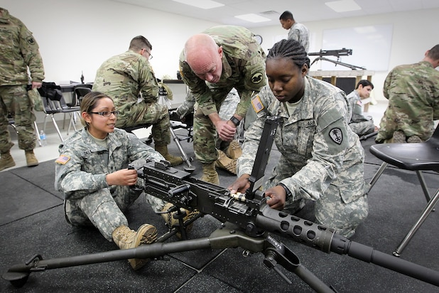 LTG Charles Luckey, Commanding General, U.S. Army Reserve, meets Spc. Vanessa Castro, left, and Pvt. 1st Class Ariana McHerron both assigned to the 822nd Military Police Company, Arlington Heights, Illinois, during training with the M2 machine gun at the Operation Cold Steel exercise at Fort McCoy, Wisconsin, Mar. 18, 2017. Operation Cold Steel is the U.S. Army Reserve's first large-scale live-fire training and crew-served weapons qualification and validation exercise to ensure that America's Army Reserve units and Soldiers are trained and ready to deploy on short-notice and bring combat-ready and lethal firepower in support of the Army and joint partners anywhere in the world. 475 crews with an estimated 1,600 Army Reserve Soldiers will certify in M2, M19 and M240 Bravo gunner platforms. 