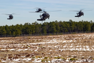 Four UH-60 Black Hawk helicopters prepare to land during a multi-component airfield seizure training exercise, part of Warrior Exercise 78-17-01, at Joint Base McGuire-Dix-Lakehurst, N.J., March 13, 2017. The helicopter crews are assigned to the Army Reserve's 8th Battalion, 229th Aviation Regiment, deployed from Fort Knox, Ky. Soldiers assigned to the 101st Airborne Division (Air Assault), acted as the opposing force during the training. Army Reserve photo by Master Sgt. Mark Bell
