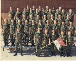 "Sgt. 1st Class John Wessely, second row, fifth Soldier from the left and Sgt. 1st Class Mark Korte, back row, third Soldier from the left, stand in formation during a ""COHORT package platoon"" photo Sept. 8, 1986 at Fort Knox, Ky. Today, Wessely and Korte are both stationed with U.S. Army Reserve 7th Mission Support Command, 457th Civil Affairs Battalion, Company D and both were promoted together Jan. 21, 2017 to Sergeant First Class."