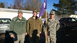 Left to right, Sgt. 1st Class John Wessely and Sgt. 1st Class Mark Korte, and Spc. Gabriel Santillanes, all with Company D, 457th Civil Affairs Battalion, 7th Mission Support Command, pose