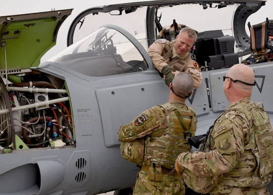Train, Advise, Assist Command-Air advisors welcome a U.S. pilot after transporting an A-29 Super Tucano light-attack aircraft arriving for duty at Kabul Air Wing, Kabul, Afghanistan, March 20, 2017. The A-29s will be used by the Afghan Air Force for close-air attack, air interdiction, escort and armed reconnaissance. These latest arrivals, which traveled from Moody Air Force Base, Ga., bring the AAF A-29 inventory from eight to 12 aircraft in country. (U.S. Air Force photo/Tech. Sgt. Veronica Pierce)
