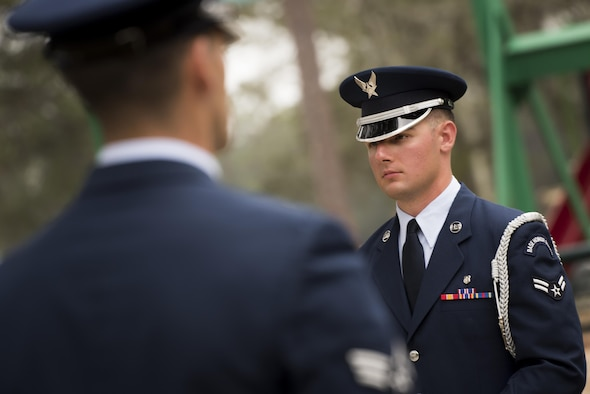 Two Honor Guard Airmen stand at attention prior to the unit's graduation ceremony at Eglin Air Force Base, Fla., March 1.  Approximately 12 new Airmen graduated from the 120-plus-hour course. The graduation performance includes flag detail, rifle volley, pall bearers and bugler for friends, family and unit commanders. (U.S. Air Force photo/Samuel King Jr.)