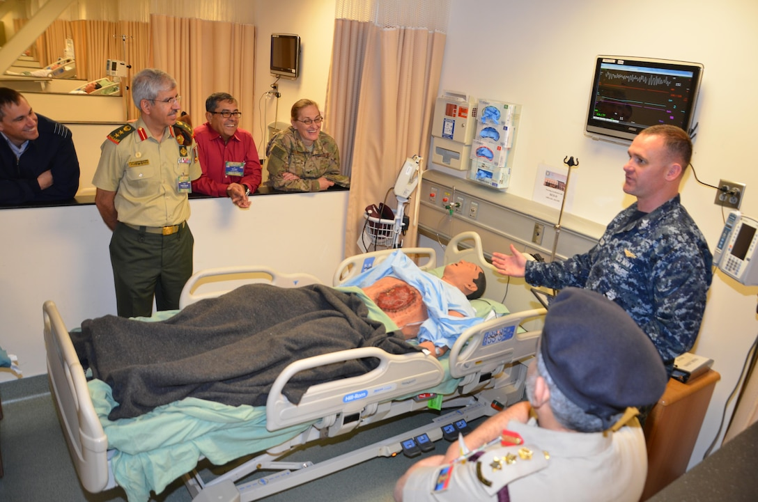 """Participants in the CENTCOM Theater Medical Conference tour the Nurse Synthesis Laboratory in the Basic Medical Technician Corpsman program at the Medical Education and Training Campus. In the lab, high-tech human-patient, high-fidelity mannequins are used to train Navy and Air Force students to evaluate and assess """"patients"""", and apply the skills they have learned to provide appropriate care. Medical professionals representing more than 10 countries within the US Central Command area of operation, Europe, and the U.S. attended the conference to aid in the continued development of capabilities that will serve to improve regional interoperability and cooperation. (Medical Education and Training Campus Public Affairs photo by Lisa Braun/Released)"""