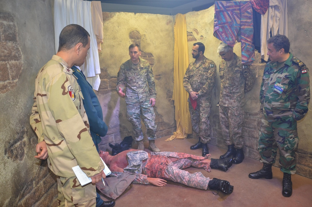 Participants in the CENTCOM Theater Medical Conference tour the Combat Trauma Patient Simulator in the Department of Combat Medic Training program at the Medical Education and Training Campus. In the CTPS, Army students apply their newly learned medical skills in a simulated combat environment. Medical professionals representing more than 10 countries within the US Central Command area of operation, Europe, and the U.S. attended the conference to aid in the continued development of capabilities that will serve to improve regional interoperability and cooperation. (Medical Education and Training Campus Public Affairs photo by Lisa Braun/Released)