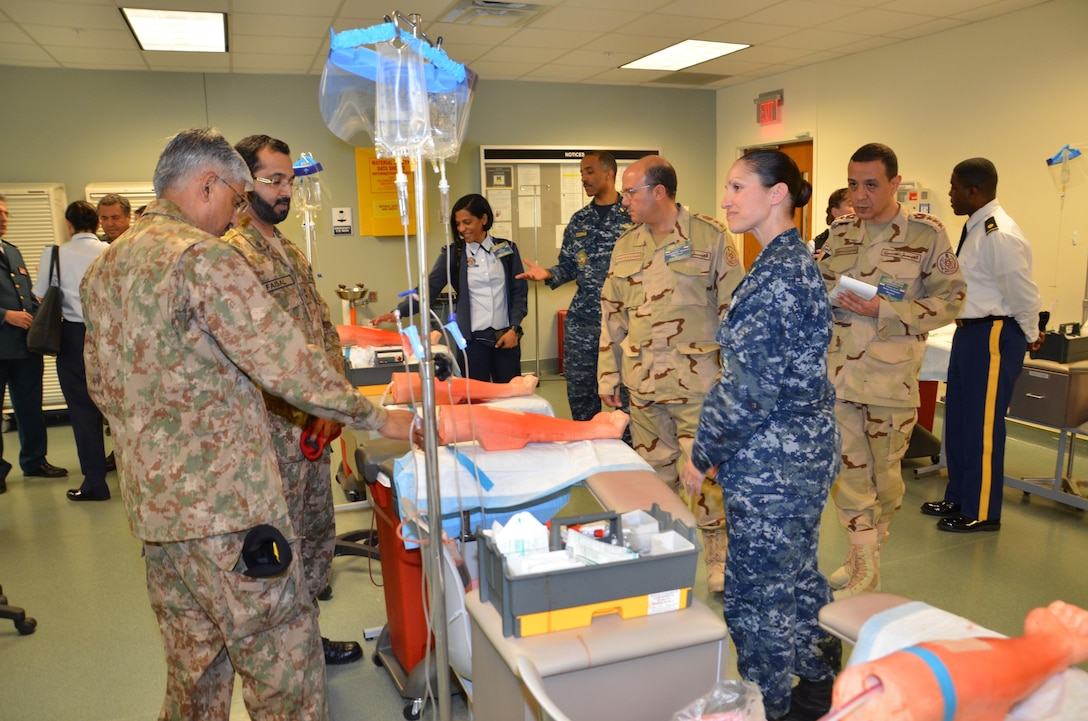 """Participants in the CENTCOM Theater Medical Conference tour the """"dead stick lab"""", which is a laboratory used in the Basic Medical Technician Corpsman Program, where students practice intravenous (IV) and venipuncture skills on simulated arms. Medical professionals representing more than 10 countries within the US Central Command area of operation, Europe, and the U.S. attended the conference to aid in the continued development of capabilities that will serve to improve regional interoperability and cooperation. (Medical Education and Training Campus Public Affairs photo by Lisa Braun/Released)"""