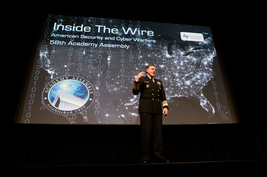 Adm. Mike Rogers, director of the National Security Agency, commander of U.S. Cyber Command commander and chief of the Central Security Service, speaks at the Academy Assembly March 14, 2017, at the U.S. Air Force Academy. The assembly is an annual conference led by undergraduates and organized by the Academy's Political Science Department. (U.S. Air Force photo/Mike Kaplan)