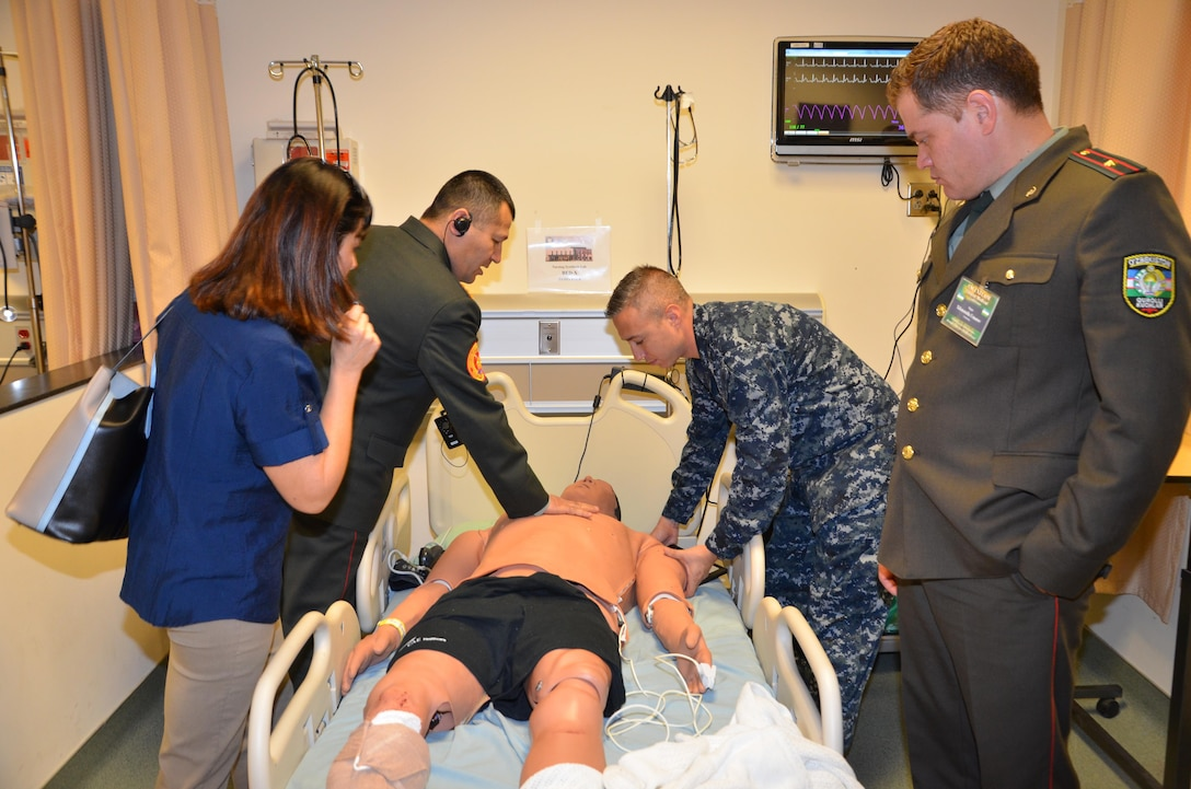 "Participants in the CENTCOM Theater Medical Conference tour the Nurse Synthesis Laboratory in the Basic Medical Technician Corpsman program at the Medical Education and Training Campus. In the lab, high-tech human-patient, high-fidelity mannequins are used to train Navy and Air Force students to evaluate and assess ""patients"", and apply the skills they have learned to provide appropriate care.  Medical professionals representing more than 10 countries within the US Central Command area of operation, Europe, and the U.S. attended the conference to aid in the continued development of capabilities that will serve to improve regional interoperability and cooperation. (Medical Education and Training Campus Public Affairs photo by Lisa Braun/Released)"