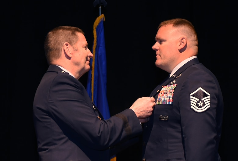 U.S. Air Force General Robin Rand, commander of Air Force Global Strike Command pins the Silver Star on retired Master Sgt. Kristopher Parker, an explosive ordnance disposal technician March 17, 2017, at Dyess Air Force Base, Texas for Parker's courageous actions while deployed to Afghanistan in May of 2014. Parker distinguished himself by bravery and devotion to duty in connection with military operations against an armed enemy of the United States as an EOD team leader. (U.S. Air Force photo by Airman 1st Class Emily Copeland)