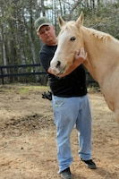 Retired Army Command Sgt. Maj. Sam Rhodes was diagnosed with post-traumatic stress disorder after serving 30-straight months in Iraq starting in 2003. Upon returning home, he discovered that horses helped him regroup. Now, he runs a nonprofit organization, the Warrior Outreach Ranch, which helps veterans and their families reconnect and relax by learning to deal with horses. Army Reserve photo by Maj. Michelle Lunato