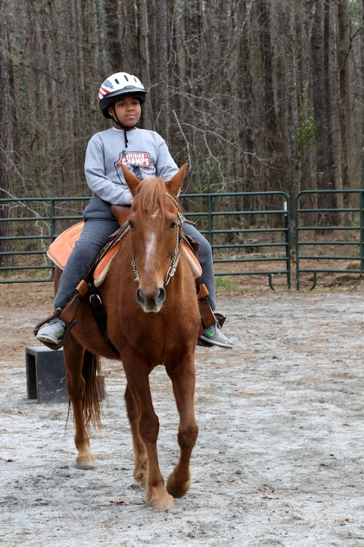 Tyler Patterson, a Boy Scout with Troop 69 out of Columbus, Ga., learns to ride a horse during a visit to the Warrior Outreach Ranch, a nonprofit organization for veterans and family members to relax and unwind through equine therapy. Army Reserve photo by Maj. Michelle Lunato