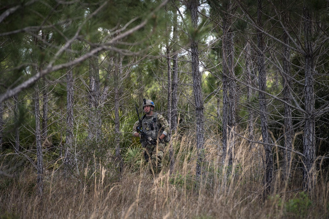 Staff Sgt. Christopher Imel, 822d Base Defense Squadron fireteam leader, patrols an area in response to reports of suspicious activity during a Mission Readiness Exercise, March 9, 2017, at Avon Park Air Force Range, Fla. The MRX took place March 2-13 and ensured the 822d BDS could efficiently deploy anywhere in the world in less than 72 hours. During the two week MRX, the squadron was evaluated on its ability to set-up a bare base, effectively thwart enemy attacks, run a secure Tactical Operation Center and maintain positive relationships with villagers in surrounding areas. (U.S. Air Force Photo by Airman 1st Class Janiqua P. Robinson)