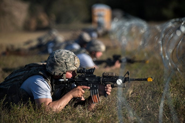 Staff Sgt. Joshua Bauer, 822d Base Defense Squadron fireteam leader, secures his sector of a defense fighting position during a Mission Readiness Exercise, March 11, 2017, at Avon Park Air Force Range, Fla. The MRX took place March 2-13 and ensured the 822d BDS could efficiently deploy anywhere in the world in less than 72 hours. The MRX took place March 2-13 and ensured the 822d BDS could efficiently deploy anywhere in the world in less than 72 hours. During the two week MRX, the squadron was evaluated on its ability to set-up a bare base, effectively thwart enemy attacks, run a secure Tactical Operation Center and maintain positive relationships with villagers in surrounding areas. (U.S. Air Force Photo by Airman 1st Class Janiqua P. Robinson)