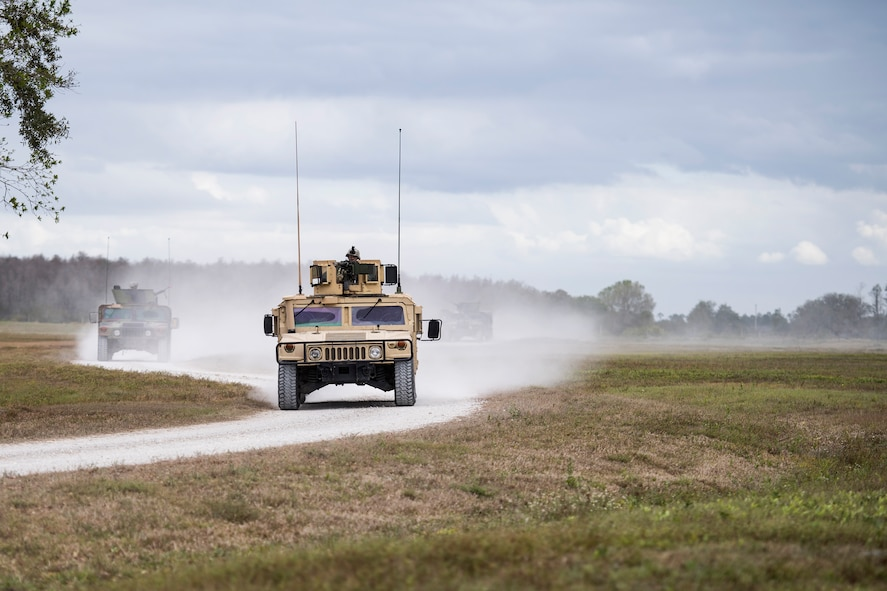 Airmen take Humvee out on patrol in response to reports of suspicious activity in a nearby village during a Mission Readiness Exercise, March 7, 2017, at Avon Park Air Force Range, Fla. The MRX took place March 2-13 and ensured the 822d Base Defense Squadron could efficiently deploy anywhere in the world in less than 72 hours. During the two week MRX, the squadron was evaluated on its ability to set-up a bare base, effectively thwart enemy attacks, run a secure Tactical Operation Center and maintain positive relationships with villagers in surrounding areas. (U.S. Air Force Photo by Airman 1st Class Janiqua P. Robinson)