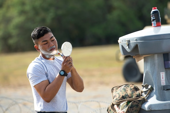 Airman Meynard Guillermo, 822d Base Defense Squadron fireteam member, shaves during a Mission Readiness Exercise, March 8, 2017, at Avon Park Air Force Range, Fla. The MRX took place March 2-13 and ensured the 822d BDS could efficiently deploy anywhere in the world in less than 72 hours. During the two week MRX, the squadron was evaluated on its ability to set-up a bare base, effectively thwart enemy attacks, run a secure Tactical Operation Center and maintain positive relationships with villagers in surrounding areas. (U.S. Air Force Photo by Airman 1st Class Janiqua P. Robinson)