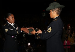 Army Reserve Sgt. Earlandrius C. Parker, a Canton, Ohio resident and a drill sergeant with the 108th Training Command (IET),  takes her drill sergeant hat from senior drill sergeant leader Sgt. 1st Class Tanya Polk, during a graduation ceremony at Fort Jackson, S.C. March 8, 2017. (U.S. Army Reserve Photo by Maj. Michelle Lunato)