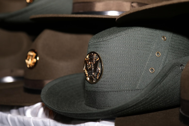 In February 1972, six Woman Army Corps noncommissioned officers from Fort McClellan, Ala., enrolled in the Drill Sergeant Program at Fort Jackson, S.C. Upon graduation, they were authorized to wear the newly designed female drill sergeant hat that was designed by Brig. Gen. Mildred C. Bailey. The design was taken from the Australian Bush Hat and was originally beige. The color changed to green in 1983 and remains in effect today.  (U.S. Army Reserve Photo by Maj. Michelle Lunato/released)