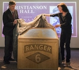 Jim and Dr. Betsy Christianson unveil the plaque for Capt. A. Marc Christianson III during the 6th Ranger Training Battalion's headquarters building dedication ceremony March 17 at Eglin Air Force Base, Fla.  The building was dedicated to Christianson, who passed away on the training range in 1972.  (U.S. Air Force photo/Samuel King Jr.)