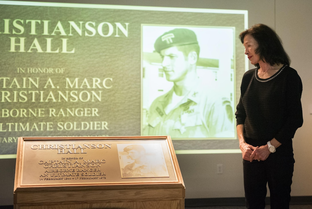 Dr. Betsy Christianson, widow of Capt. A. Marc Christianson III, admires the remembrance plaque during the 6th Ranger Training Battalion's headquarters building dedication ceremony March 17 at Eglin Air Force Base, Fla.  The building was dedicated to Christianson, who passed away on the training range in 1972.  (U.S. Air Force photo/Samuel King Jr.)
