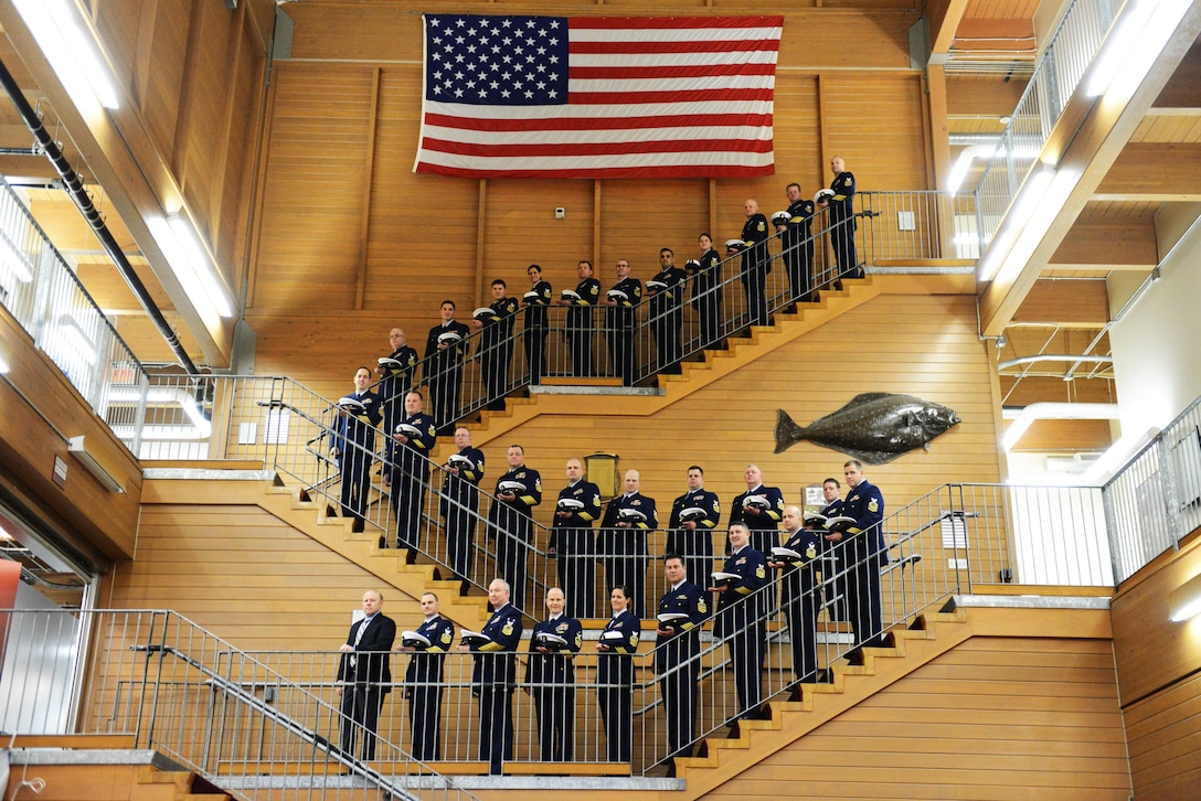The Coast Guard Kodiak Consolidated Chief's Mess stand together in service dress blue uniforms at the North Pacific Regional Fisheries Training Center on Base Kodiak, Alaska, April 28, 2016, to raise awareness and demonstrate their commitment to ending sexual assault in the Coast Guard.  Coast Guard photo by Petty Officer 1st Class Kelly Parker