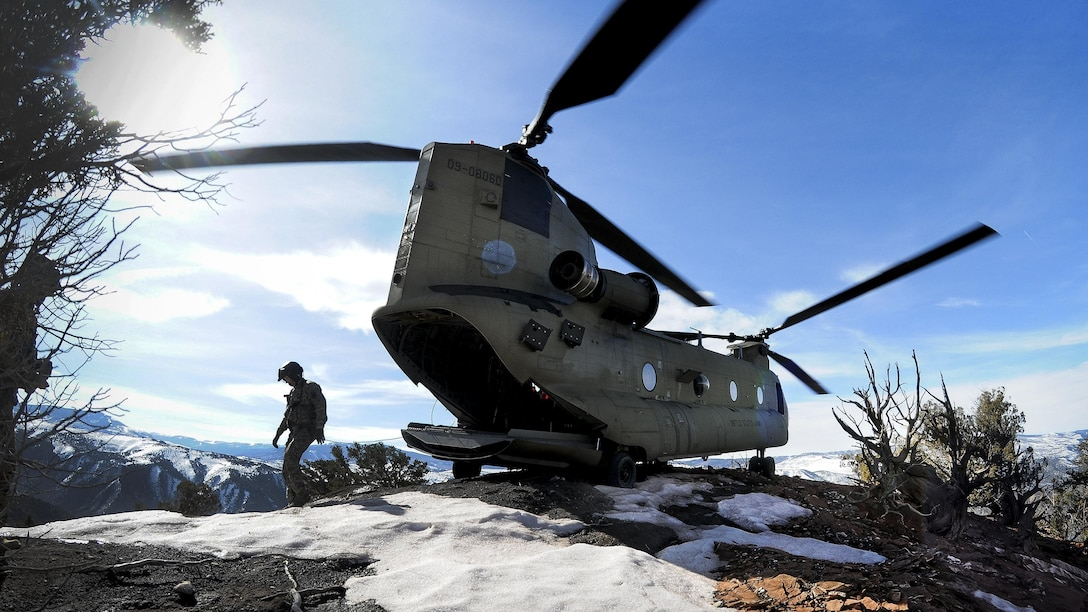 Soldiers walk around their CH-47F Chinook helicopter after landing on a mountaintop during high-altitude flight operations near Vail, Colo., March 10, 2017. The soldiers are assigned to the South Carolina Army National Guard's Company B, 2nd Battalion, 238th General Support Aviation Regiment. Army National Guard photo by Staff Sgt. Roberto Di Giovine