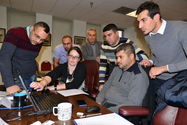 Vanessa Bateman, chief of the U.S. Army Corps of Engineers Nashville District Civil Design Branch, teaches how to input information to five engineers from the Ministry of Water Resources at the Mosul Dam project in Iraq and one engineer from Trevi S.p.A., the construction company working on the project.  The group recently completed three weeks of training with a U. S. Army Corps of Engineers Data Management Reach Back Team.