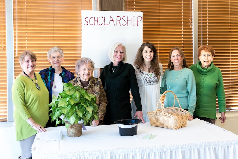 Members of the AEDCWC pause for a photo with singer and songwriter Carson Hill (fifth from left) during the Woman's Club meeting March 2. Pictured with Hill, left to right, are Anne-Marie Pender, Kelly Doyle, Jane Modrell, Suzette McCrorey, Carson, Cecelia Schlagheck and Jane Ricci. (courtesy photo)