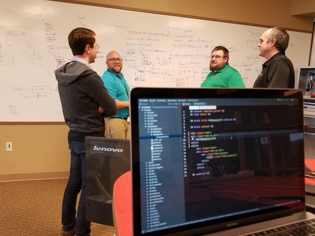 AFRL researcher Matt Jacobsen (second from left), developer of the Hyperthought data management and sharing software, strategizes with team members Kevin Porter, James Fourman, and Jason Thiese during a recent collaboration session at the AFRL Maker Hub. (U.S. Air Force photo/Holly Jordan)