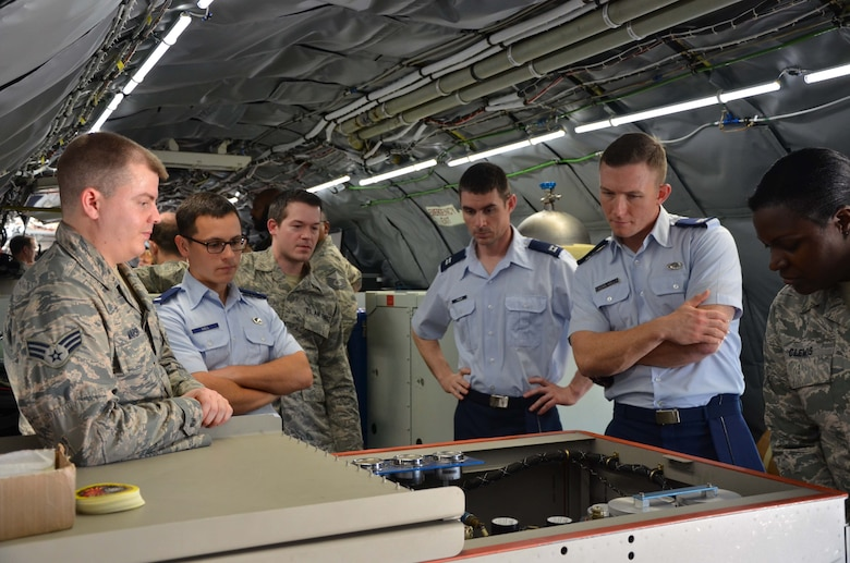 Senior Airman Tristan Marsh (left), briefs a group of visitors on the capabilities of the WC-135 Constant Phoenix Feb. 14, 2017.  The jet was on display at Patrick AFB, Fla., for members of the Air Force Technical Applications Center and the 45th Space Wing.  As people made their way through and around the aircraft, crewmembers discussed the features and capabilities of the atmospheric collection suite, which allows the mission crew to detect radioactive 'clouds' in real time. (U.S. Air Force photo by Susan A. Romano)