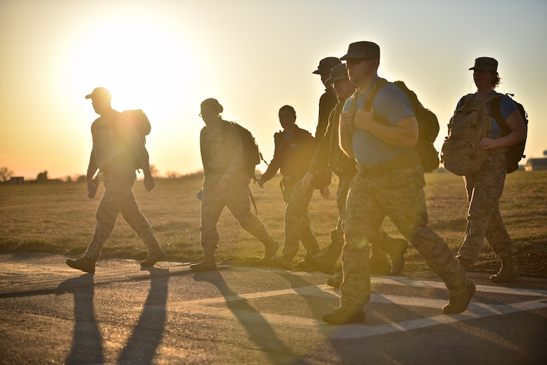 Members of the 932nd Airlift Wing walk the Scott Air Force Base perimeter track, March 3, 2017, in preparation for the Bataan Memorial Death March, held at the White Sands Missile Range in New Mexico.  The march honors the approximately 10,000 men that died during the 65 miles to confinement camps throughout the Philippines.  April 9, 2017 marks the 75th anniversary of the Bataan Death March. (U.S. Air Force photo by Tech. Sgt. Christopher Parr)