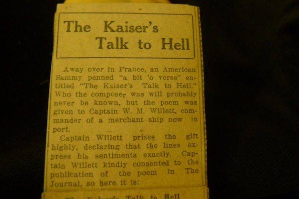 A folded comedic poem printed on the back of a water-department flyer was in Leon Bell's wallet. The poem depicts Kaiser Wilhelm using the telephone to call Satan for advice on how to do better against the American forces.