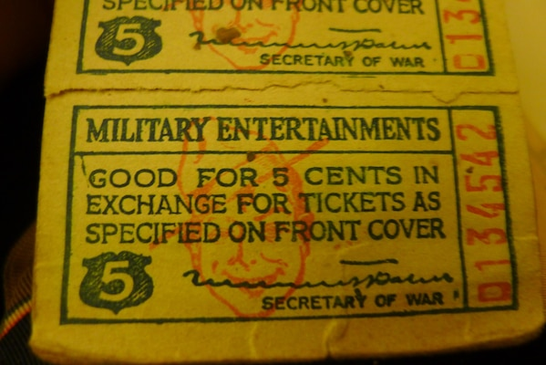 "A ticket booklet gave ""doughboys"" access to movies and other entertainment while on liberty, en route to the combat zone."