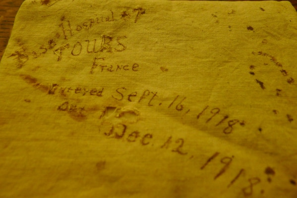 Cotton sheet or pillowcase with dates of Sgt. Bell's time at the base hospital in Tours, France, recuperating from Spanish Flu.
