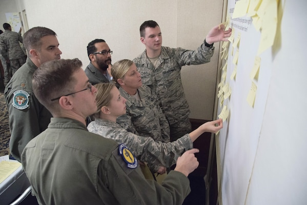 JBSA participants in a Chief of Staff of the Air Force focus group on revitalizing squadrons rearrange sticky notes of ideas to improve squadron level activities at Joint Base San Antonio-Randolph Mar. 16, 2017. Focus groups are being held at 23 bases across the Air Force throughout 2017 to support the initiative. (U.S. Air Force Photo by Sean M. Worrell)