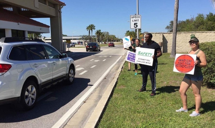 Volunteers share St. Patrick's Day safety messages with members of Team MacDill at MacDill Air Force Base, Fla., March 17, 2017. The 6th Air Mobility Wing Safety Office organized the safe driving campaign as a reminder for personnel to drive safely and drink responsibly. (U.S. Air Force photo by Tech. Sgt. Peter Dean)
