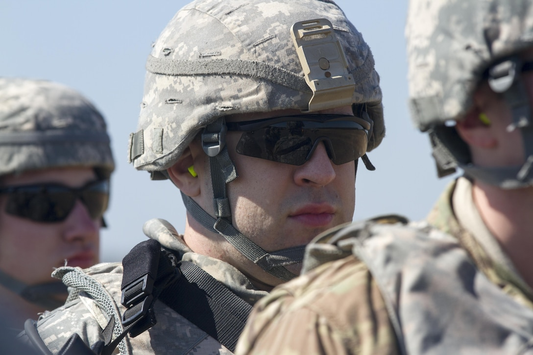 Military Policemen assigned to 340th Military Police Co., 333rd Military Police Brigade, 200th Military Police Command, U.S. Army Reserve, stand ready for onward movement to their tactical assembly area after arriving at Lakehurst Maxfield Field, N.J., Mar 19, 2017, during Warrior Exercise 78-17-01. WAREX 78-17-01 is an important step in building the most capable, combat-ready and lethal force in history. (U.S. Army Reserve photo by Staff Sgt. George F. Gutierrez, 201st Press Camp Headquarters/ Released)