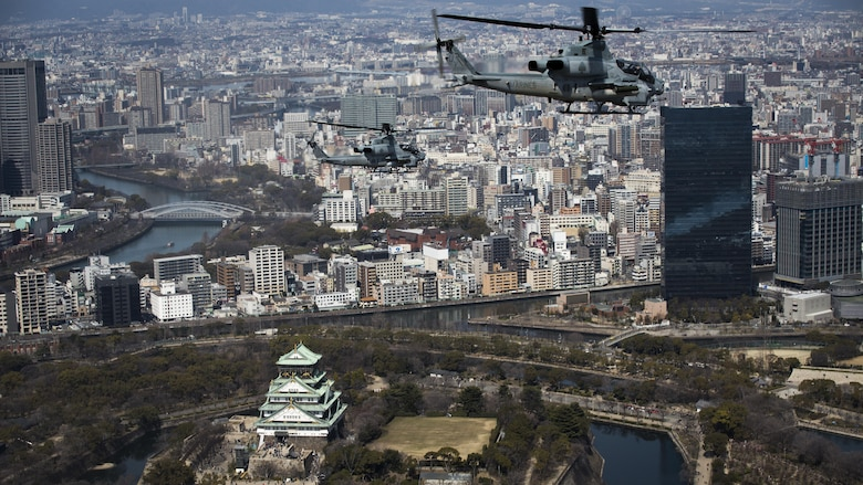 AH-1Z Vipers soar through the skies over Osaka Castle, Osaka, Japan, March 12, 2017. Marine Light Attack Helicopter Squadron 267 validated the long-range capability of the auxiliary fuel tanks on their H-1 platform helicopters by flying 314 nautical miles during one leg of the journey, March 10.