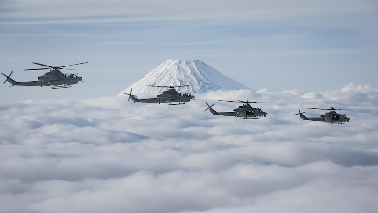Marine Light Attack Helicopter Squadron 267 AH-1Z Viper and UH-1Y Venom helicopters past Mount Fuji, Shizuoka, Japan, March 12, 2017. The squadron, currently supporting Marine Aircraft Group 36, 1st Marine Aircraft Wing, III Marine Expeditionary Force, validated the long-range capability of auxiliary fuel tanks on their H-1 platform helicopters by flying 314 nautical miles during one leg of the four-day mission, March 10.